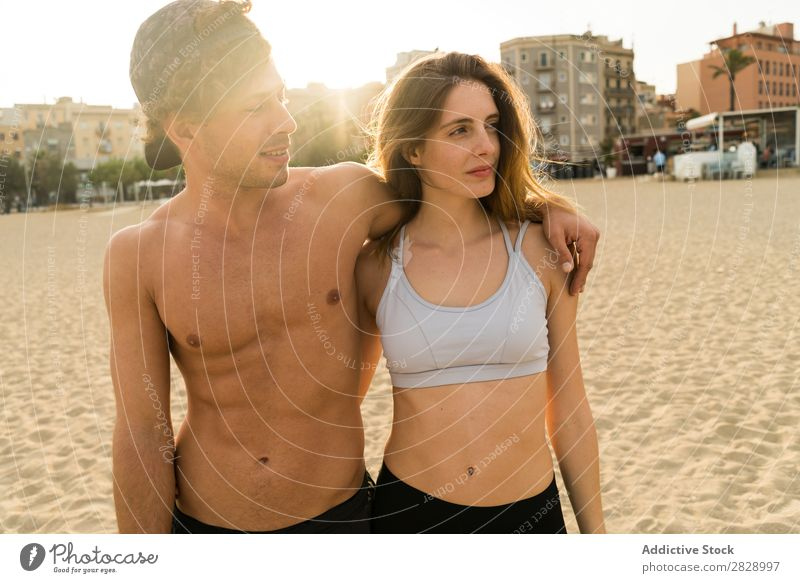 Young sportive couple embracing Couple Beach Teamwork Athletic Town Embrace Coast motivation Fitness Landscape City Support shirtless Sportswear Happiness