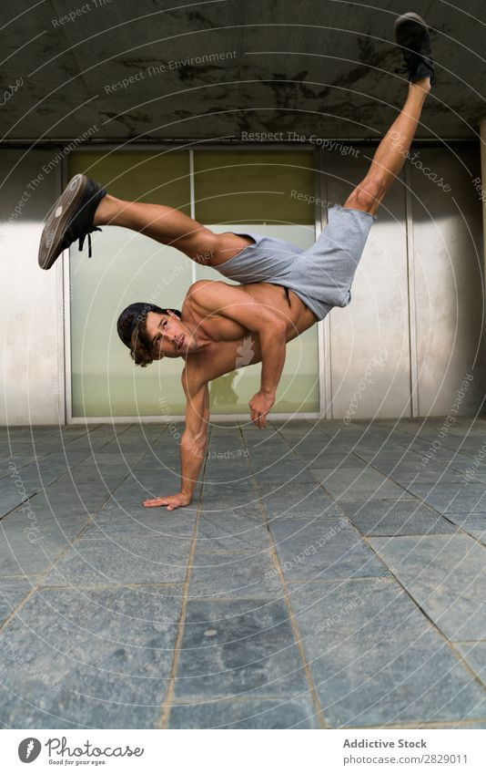 Shirtless man in handstand on street Man Handstand Practice Town Fitness Balance Sports Freedom Endurance Stand pose Power upside Energy Street Strong Athlete