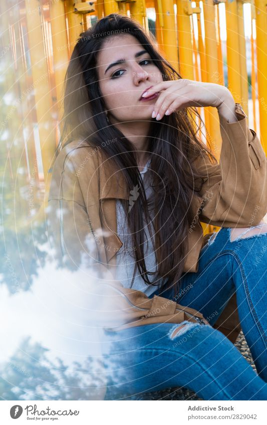 Young and pretty brunette sitting outside looking pensive. Woman Style Pensive Exterior shot Town Modern Hip & trendy Elegant Easygoing Attractive Model Adults