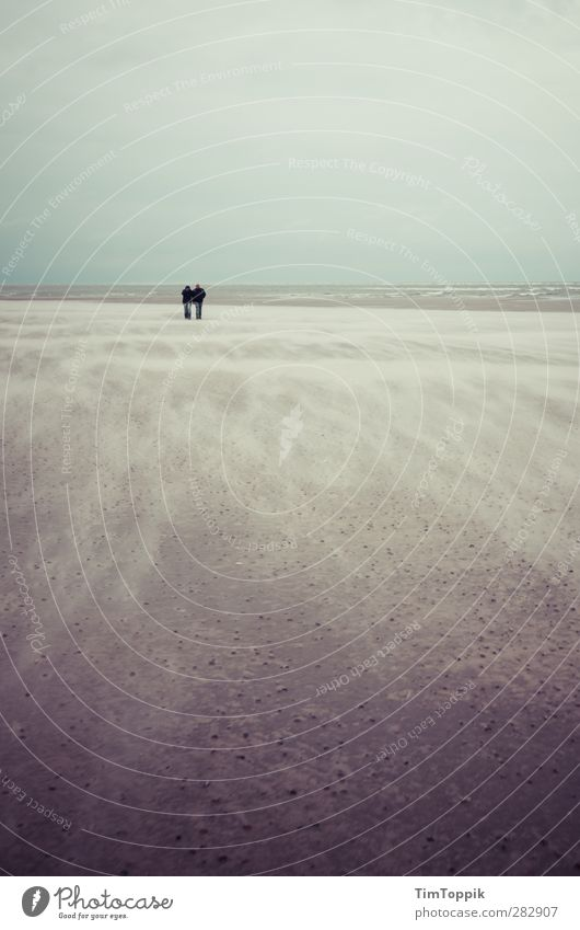 Nowhere #4 Beach Together Lovers Sand Sandy beach Sandstorm Langeoog Ocean Waves To go for a walk Walk on the beach Couple Gale Sadness Sentimental Trust