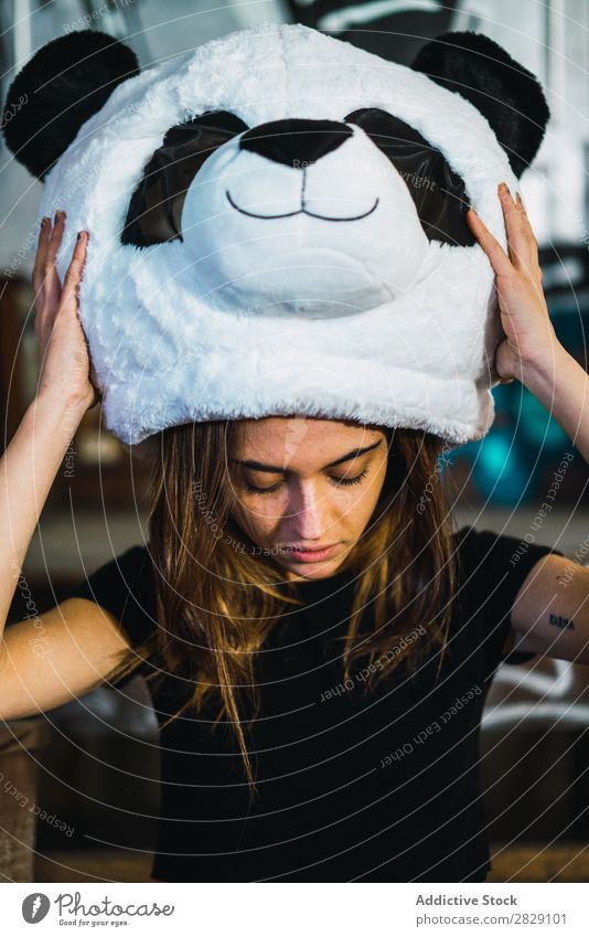 Pretty woman with plush panda head Woman Joy Panda Mask Costume Plush Head Smiling