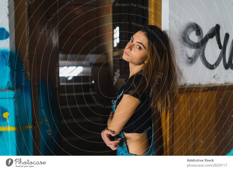 Woman posing in abandoned building Building Cheerful Posture Graffiti Attractive To enjoy Hair Set Youth (Young adults) Portrait photograph Beautiful Lifestyle