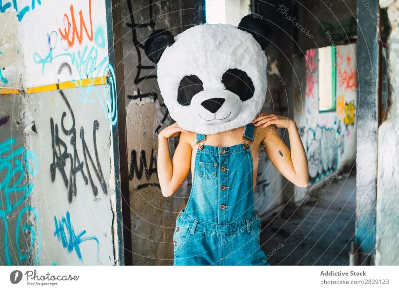 Topless woman in abandoned building with plush panda head Woman Posture Eroticism Hot To enjoy Attractive Covering