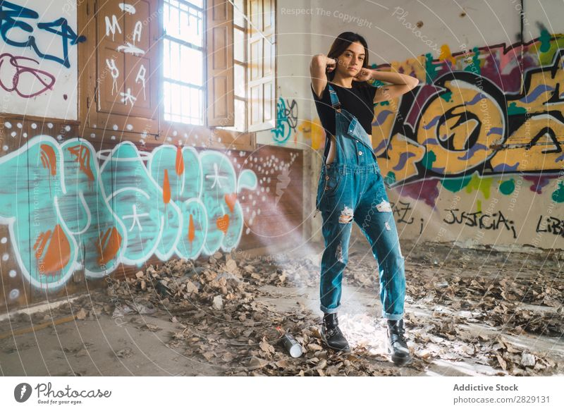 Woman setting hair in abandoned building Building Smiling Cheerful Posture Looking into the camera Graffiti Attractive To enjoy Hair Set Youth (Young adults)