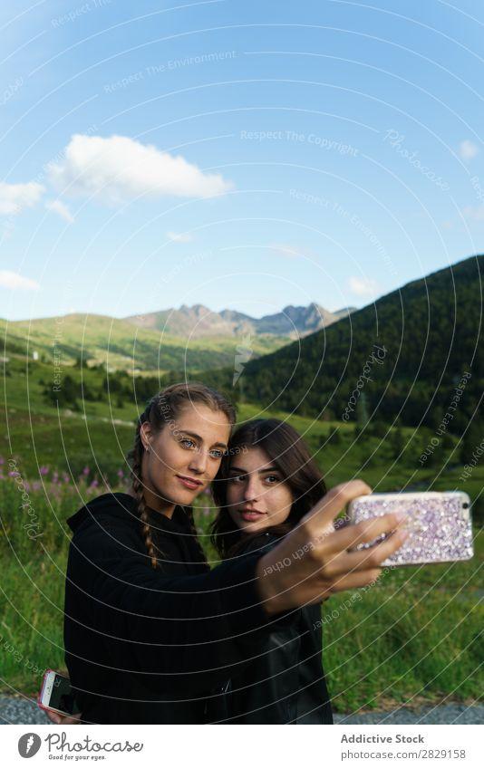Women taking selfie on meadow Woman Selfie Meadow PDA Summer Youth (Young adults) Portrait photograph Grass