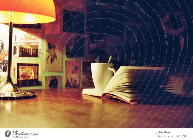 Relaxation Think Book Lifestyle Living or residing Table Reading Drinking Kitchen Fatigue Cup Cozy Page Print media Homey Table lamp