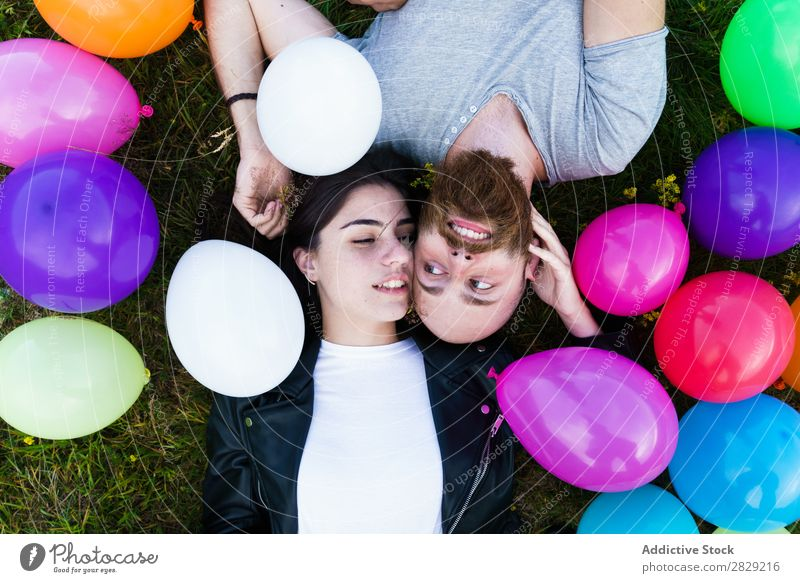 Couple having fun in balloons Woman Man Together Smiling Love Nature Friendship