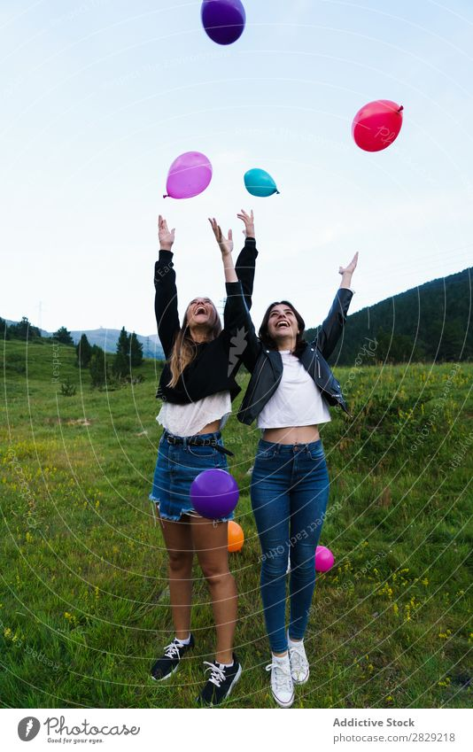 laughing women throwing up balloons Woman Nature Friendship Together Human being Hands up! Posture Freedom