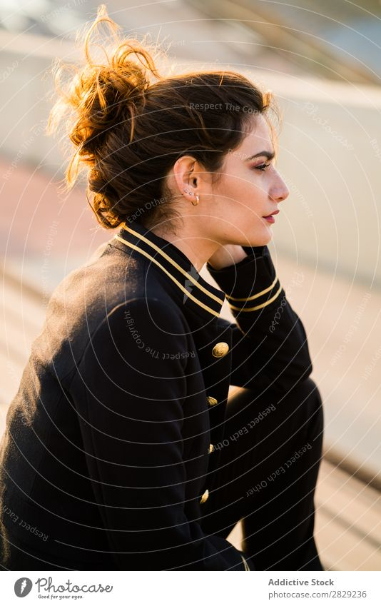 Woman in casual looking away woman stairs sitting clothes confident stylish serious young hair female beautiful girl attractive glamour lady gorgeous hairstyle