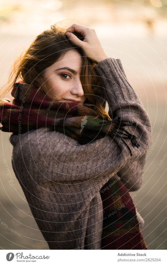 Woman posing in sweater holding hair Looking into the camera Sweater Cheerful Smiling Happy Youth (Young adults) Hair Beautiful Girl Attractive Self-confident