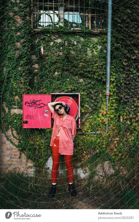 Woman posing at fire hose Style Street Town Fire-fighting tube Red Posture Plant Growth Sunglasses Portrait photograph Attractive Beauty Photography