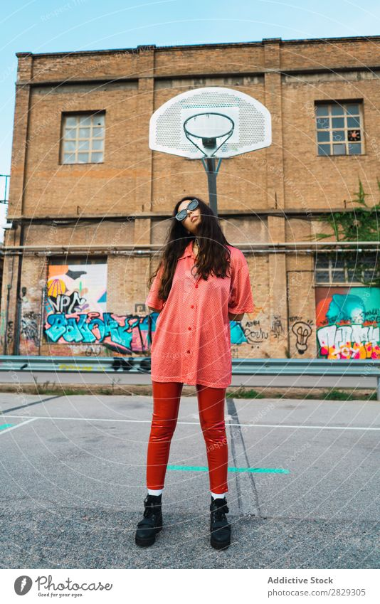 Woman standing at playground Style Street Fence Town Posture Portrait photograph Attractive Beauty Photography Hip & trendy Lifestyle pretty Fashion