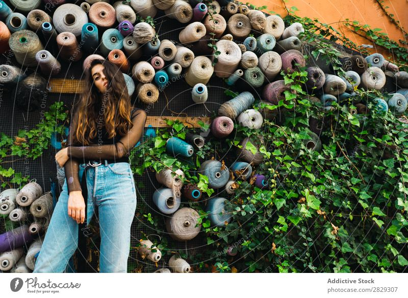 Woman at wall with rolls Style Street Wall (building) Plant Roll Bushes Town Posture Portrait photograph Attractive Beauty Photography Hip & trendy Lifestyle