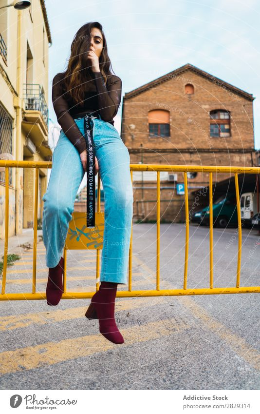 Woman sitting at fence Style Street Town Posture Sit Fence Asphalt Portrait photograph Attractive Beauty Photography Hip & trendy Lifestyle pretty Fashion