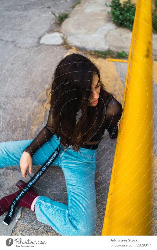 Woman sitting near fence Style Street Town Posture Sit Fence Asphalt Portrait photograph Attractive Beauty Photography Hip & trendy Lifestyle pretty Fashion