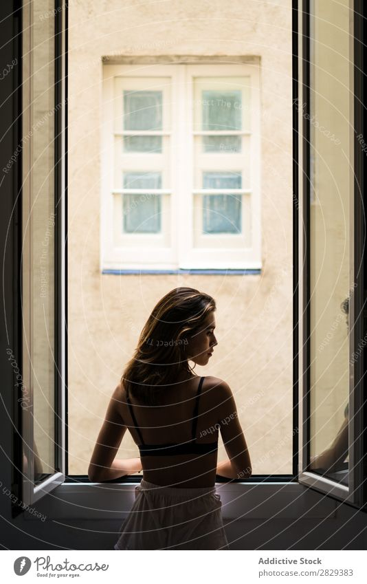 Attractive woman holding hair at window Woman Home Youth (Young adults) Beautiful Window Posture To enjoy Hot pretty Beauty Photography Happy Human being Room