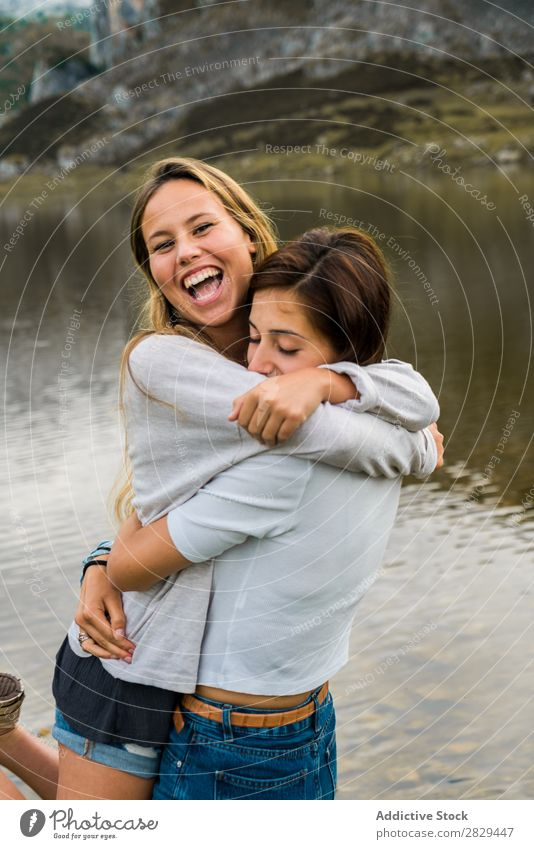 Girls hugging at lake Woman Meadow Lake embracing Stand Together Friendship Relaxation Mountain Nature Field Grass Beautiful Youth (Young adults) Green Spring