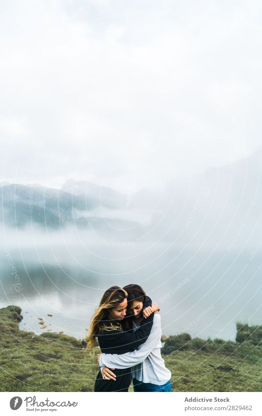 Women at foggy lake Woman Meadow Lake embracing Fog Stand Together Friendship Relaxation Mountain Nature Field Girl Grass Beautiful Youth (Young adults) Green