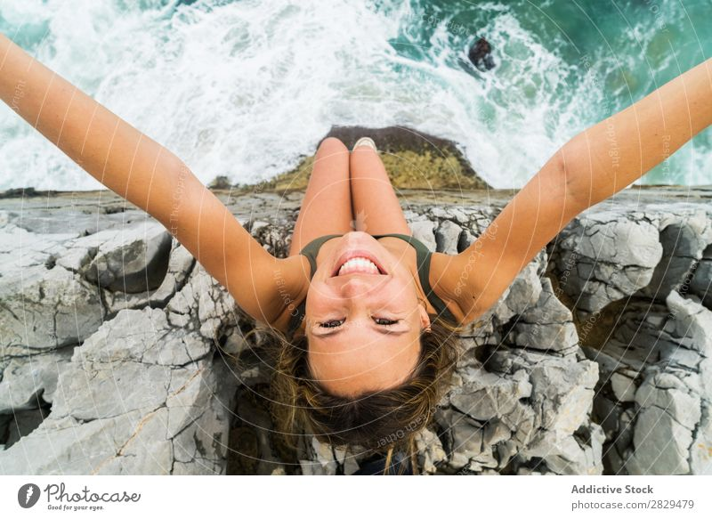 Woman taking selfie at edge of rock Cliff Ocean Sit Beautiful Rock Summer Nature Vacation & Travel Water Landscape Youth (Young adults) Blue Lifestyle Freedom