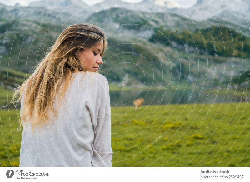 Woman relaxing in mountain meadow Meadow Relaxation Sit Handrail Mountain eyes closed Nature Field Girl Grass Beautiful Youth (Young adults) Green Spring