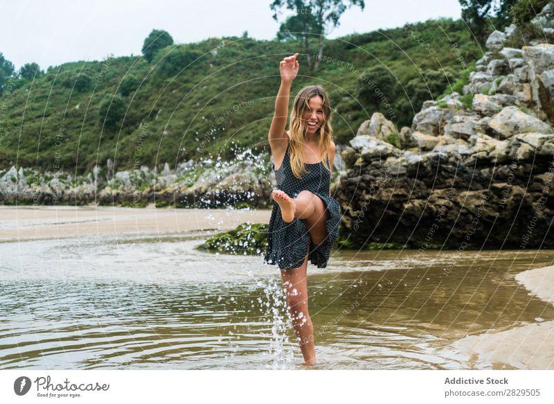 Cheerful girl playing in water Woman Water Beach Splashing Nature Happiness Vacation & Travel