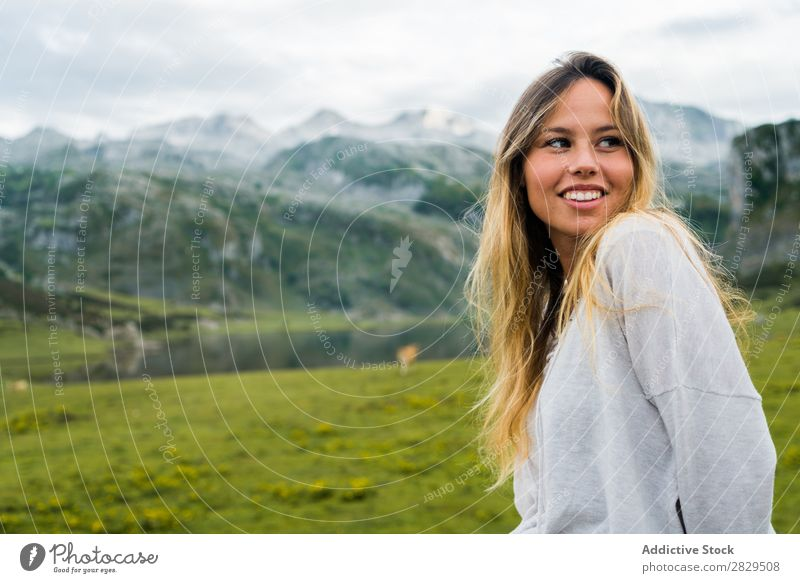 Woman posing in mountain meadow Meadow Relaxation Mountain Nature Field Girl Grass Beautiful Youth (Young adults) Green Spring Human being Happiness Freedom