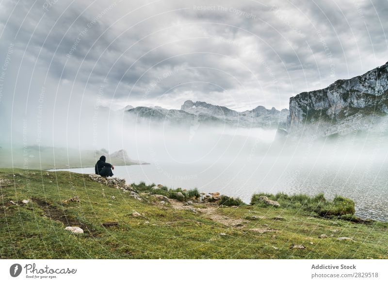 Anonymous person on lake in mountains Human being Mountain Lake Fog Mysterious Nature Landscape travelers Peaceful Natural Adventure Mystery Silhouette Lakeside