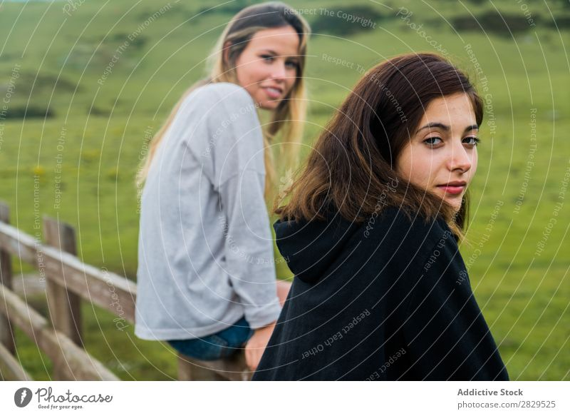 Women sitting at mountain pasture Woman Meadow Sit Handrail Relaxation Mountain Cow Pasture Nature Field Girl Grass Beautiful Youth (Young adults) Green Spring