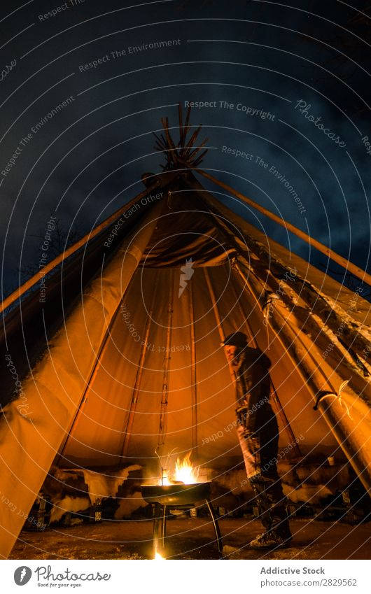 Man warming in tent Winter Nature Cold North Covered Tent Light Night Bonfire Human being Stand Tourist traveller Forest Snow Seasons White Landscape Ice Frost