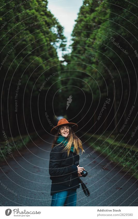 Smiling woman with camera in woods Woman Photographer Forest Green Nature Camera Hat Youth (Young adults)