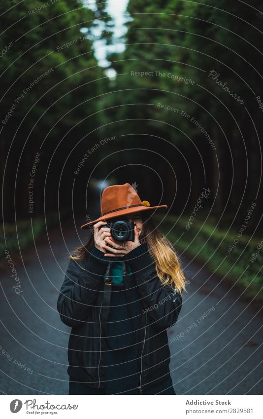 Woman with camera in woods Photographer Forest Green Nature Camera Hat Youth (Young adults)