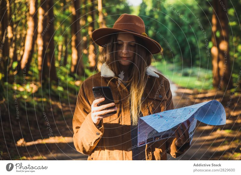 Woman with map in woods Exterior shot Forest Leaf Lost Colour Plant Day