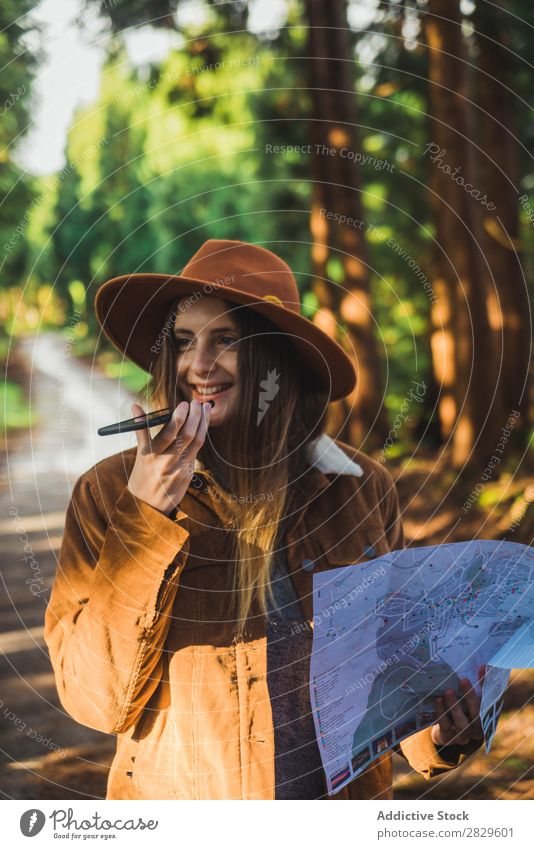 Woman with map in woods Exterior shot scenery Forest Leaf Lost Colour Plant Day Natural Tourist Wild Beautiful Seasons Fresh Spring Multicoloured