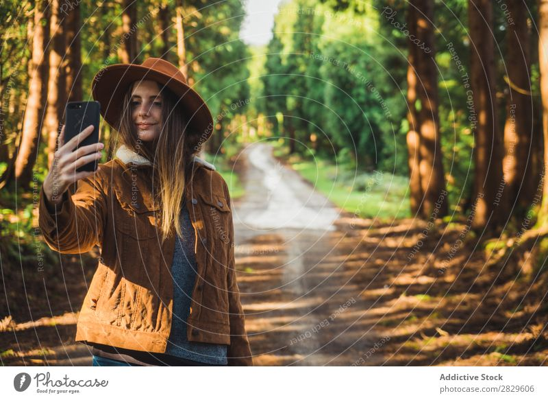 Smiling woman taking selfie in woods Woman Tourist Forest Green Nature Environment Cheerful