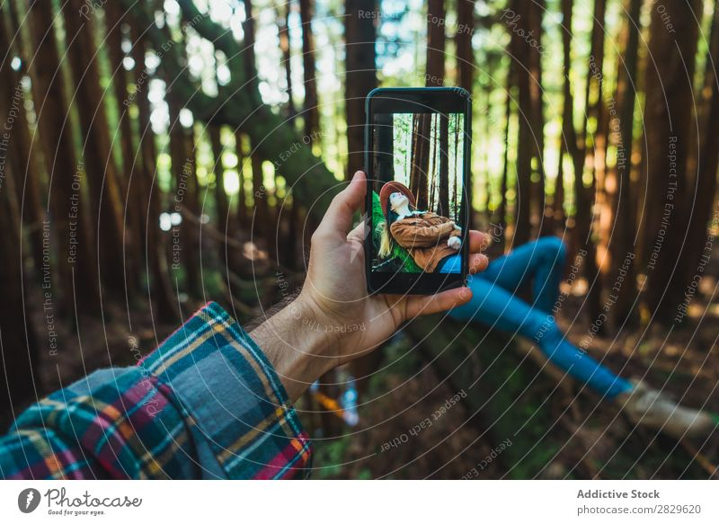 Hand taking shot of relaxing woman Woman Tourist Forest Green Nature Trunk Relaxation