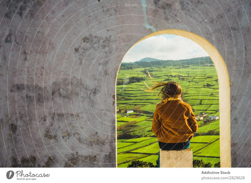 Woman in arch looking at field Arch Building Field Green Nature Meadow Spring Summer Grass Landscape Agriculture Rural Sunlight Farm Beautiful Lawn Environment