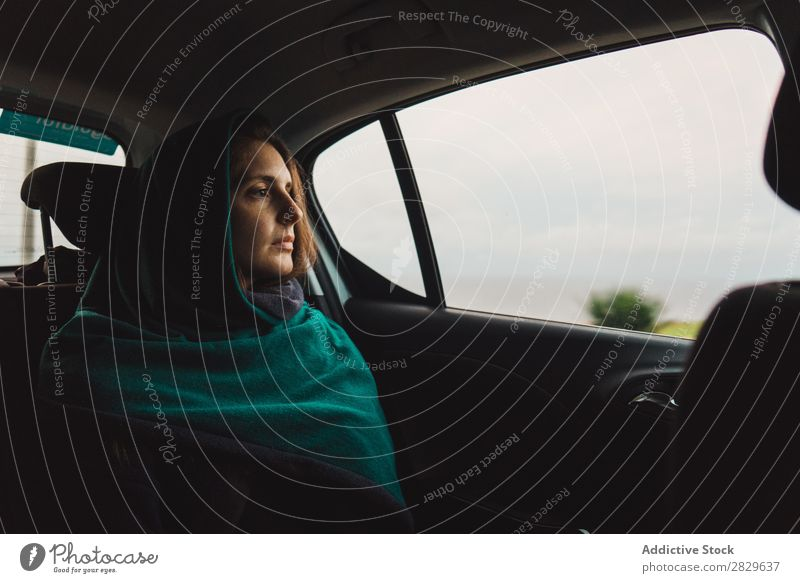 Woman riding in car looking away Car Dream Vacation & Travel Traveling contemplate Inspiration Sadness Interior shot Window Relaxation traveler backseat