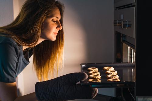 Woman making cookies in oven Stove & Oven Cookie Baking Preparation checking sheet pan Fresh Tray Make Confectionary Flat (apartment) Kitchen Bakery Baked goods