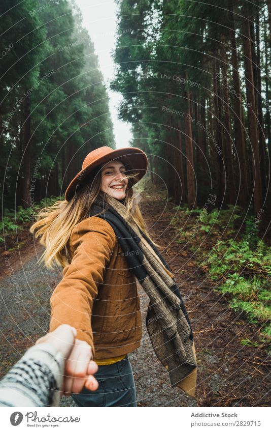 Woman holding hand of photographer in woods Forest follow me romantic Together holding hands Street enchanted Wilderness Lush Plant Cheerful leading Jacket