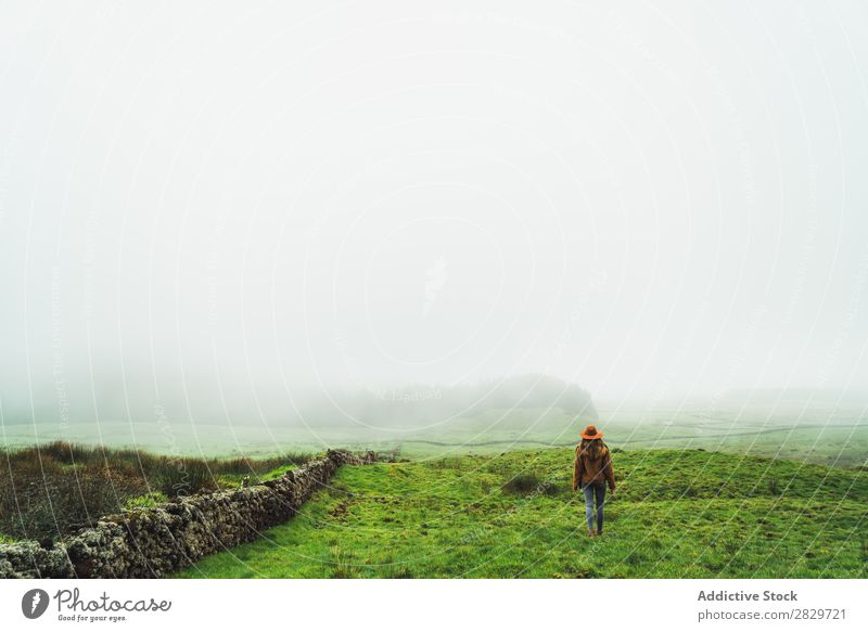 Content woman in green foggy fields Woman Fog Grassland Cold Freedom Vacation & Travel Wilderness enjoyment Weather Joie de vivre (Vitality) Peaceful Rural