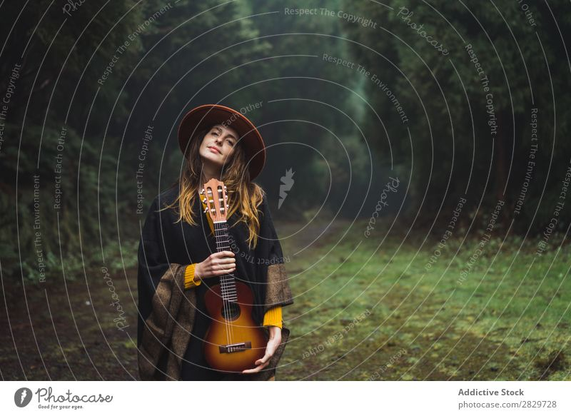 Charming woman with ukulele in nature Woman traveler Forest Ukulele Adventure Music Landscape Dream instrument Lifestyle Song Excitement Musician romantic