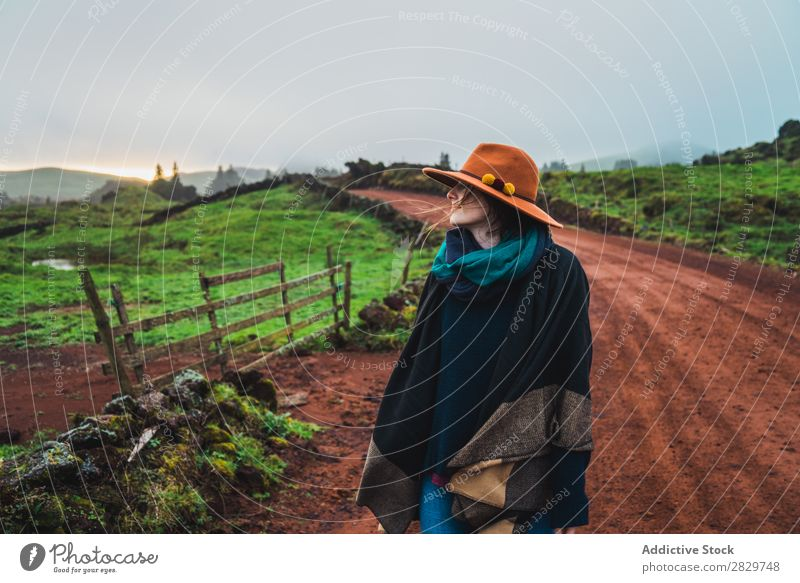 Woman on rural green road Nature Rural Landscape Street Fog Cold Lanes & trails pathway Countries Dream Calm Stand Tourism tranquil Pensive Vacation & Travel