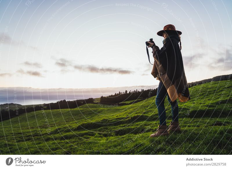 Woman in green cold fields Grassland Freedom Field Peaceful Nature Rural Wilderness scenery Stand Green Landscape Fog Dream Pasture Tourism tranquil Valley Cold