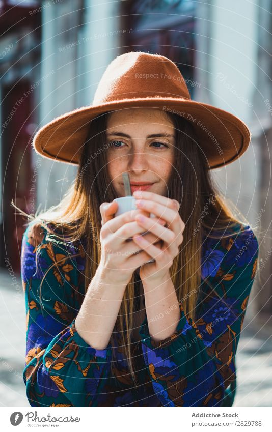 Smiling woman with cup in outside cafe Woman pretty Style Street Hat Coffee Cup Café Exterior shot Fashion Beautiful Youth (Young adults) Portrait photograph