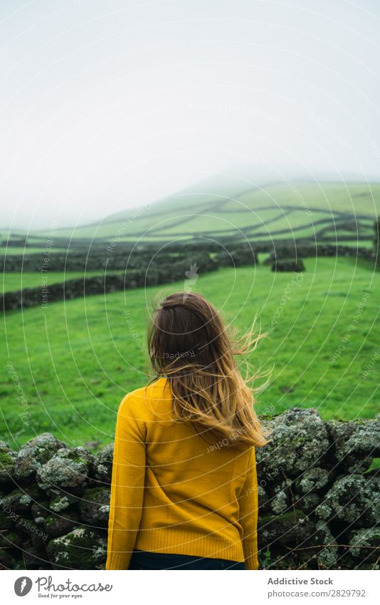 Woman at green field Field Green Vantage point Tourism Vacation & Travel Stand Smiling Nature Fence Landscape Stone Fog Grass Meadow Rural Clouds Seasons