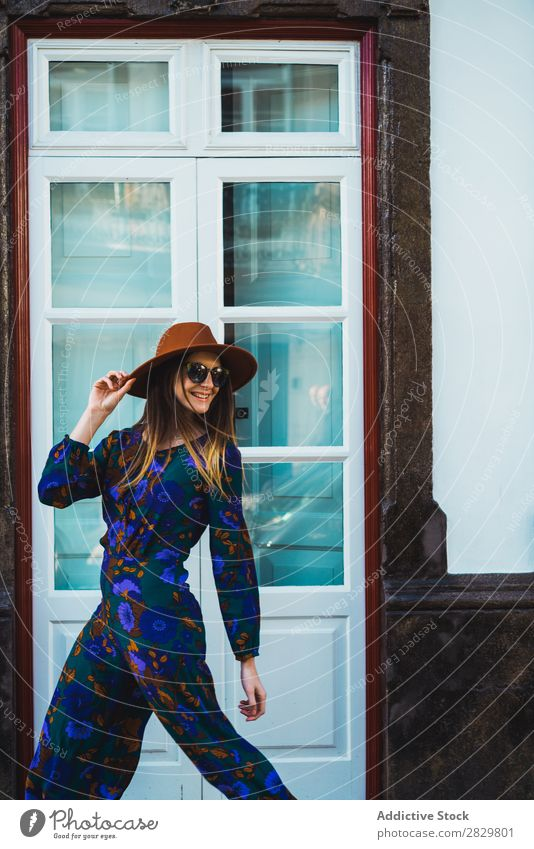 Cheerful stylish woman in hat Woman pretty Style Street Hat Walking Sunglasses Door Looking back Exterior shot Fashion Beautiful Youth (Young adults)