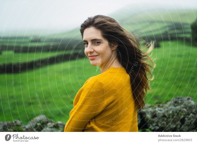 Smiling woman at green field Woman Field Green Vantage point Tourism Vacation & Travel Stand Nature Fence Landscape Stone Fog Grass Meadow Rural Clouds Seasons