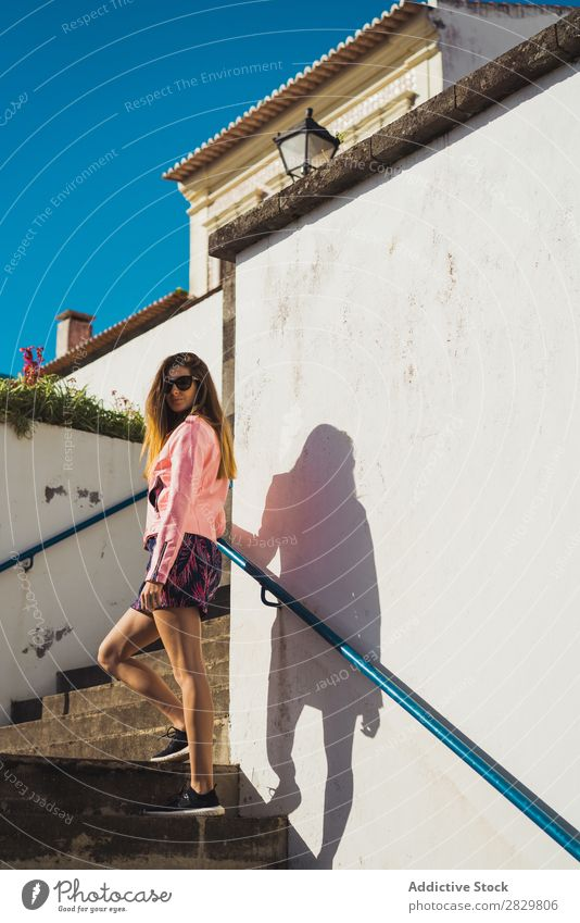 Young pretty woman on stairs Woman Style Street Sunglasses Steps Stairs Sunbeam Exterior shot Fashion Beautiful Youth (Young adults) Portrait photograph