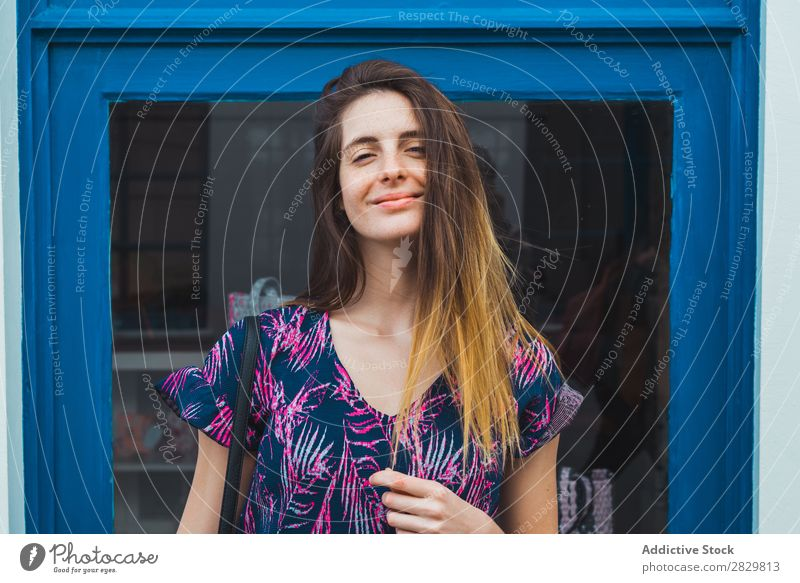 Smiling woman posing on street Woman pretty Style Street Posture Window Exterior shot Fashion Beautiful Youth (Young adults) Portrait photograph Attractive City