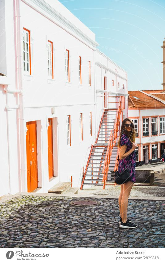 Cheerful woman standing on street Woman pretty Style Stand Sunglasses Sunbeam Street Exterior shot Fashion Beautiful Youth (Young adults) Portrait photograph